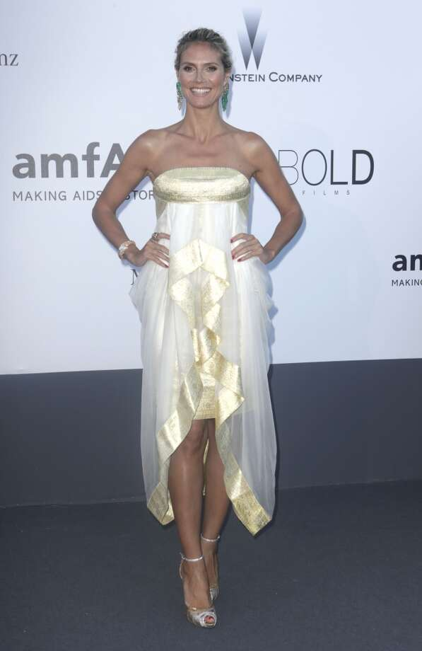 Model Heidi Klum arrives at amfAR Cinema Against AIDS benefit at the Hotel du Cap-Eden-Roc, during the 66th international film festival, in Cap d'Antibes, southern France, Thursday, May 23, 2013. (Photo by Joel Ryan/Invision/AP)