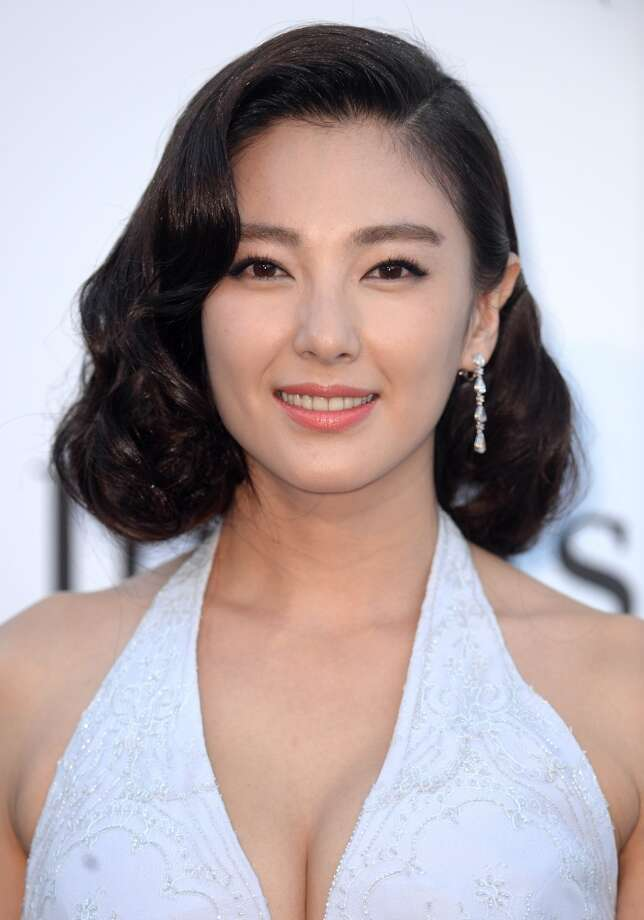 CAP D'ANTIBES, FRANCE - MAY 23:  Zhang Yuqi attends amfAR's 20th Annual Cinema Against AIDS during The 66th Annual Cannes Film Festival at Hotel du Cap-Eden-Roc on May 23, 2013 in Cap d'Antibes, France.  (Photo by Samir Hussein/French Select via Getty Images)