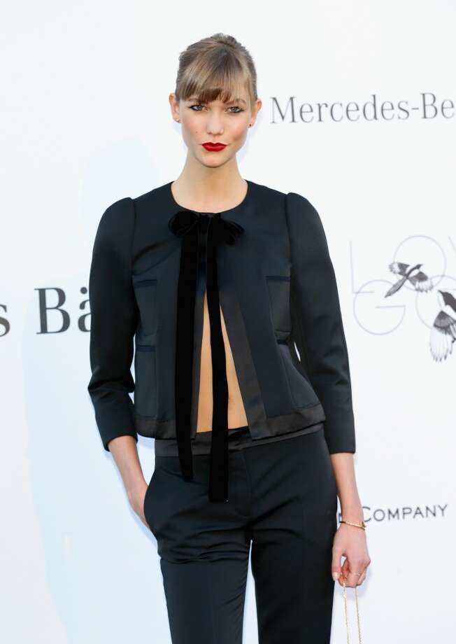 CAP D'ANTIBES, FRANCE - MAY 23:  Model Karlie Kloss attends amfAR's 20th Annual Cinema Against AIDS during The 66th Annual Cannes Film Festival at Hotel du Cap-Eden-Roc on May 23, 2013 in Cap d'Antibes, France.  (Photo by Vittorio Zunino Celotto/French Select via Getty Images)