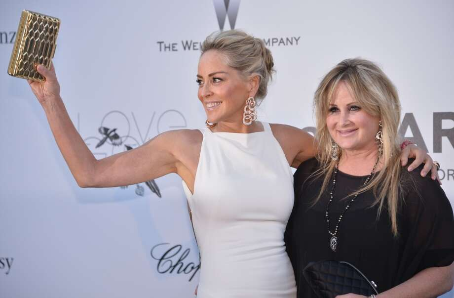 US actress Sharon Stone smiles on May 23, 2013 as she arrives with her sister Kelly for the amfAR's 20th Annual Cinema Against AIDS during the 66th Annual Cannes Film Festival at Hotel du Cap-Eden-Roc in Cap d'Antibes, southern France.   AFP PHOTO / ALBERTO PIZZOLIALBERTO PIZZOLI/AFP/Getty Images