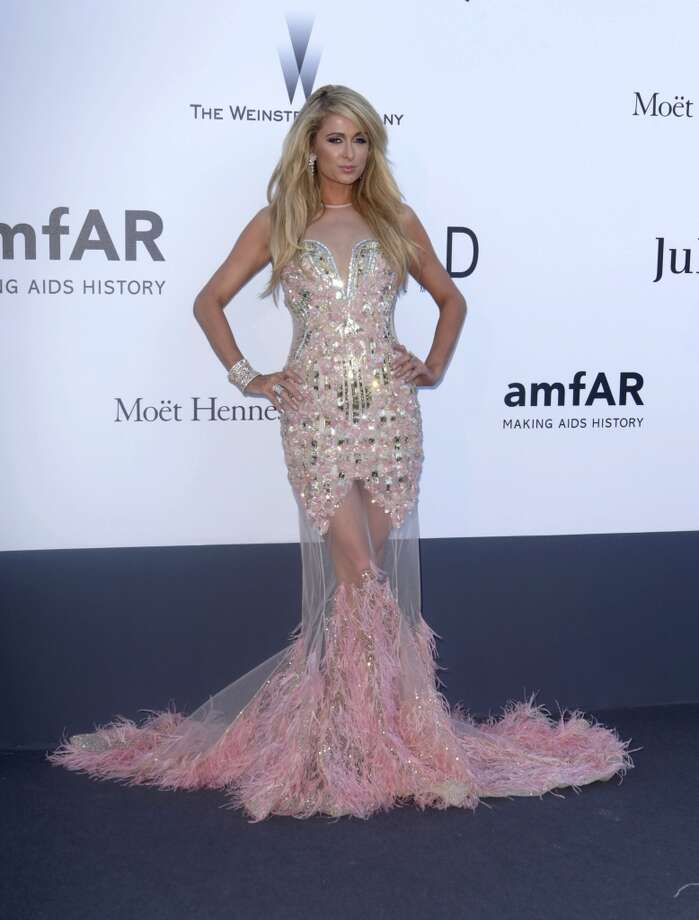 Socialite Paris Hilton arrives at amfAR Cinema Against AIDS benefit at the Hotel du Cap-Eden-Roc, during the 66th international film festival, in Cap d'Antibes, southern France, Thursday, May 23, 2013. (Photo by Joel Ryan/Invision/AP)