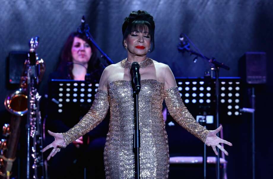CAP D'ANTIBES, FRANCE - MAY 23:  Dame Shirley Bassey performs on stage at amfAR's 20th Annual Cinema Against AIDS during The 66th Annual Cannes Film Festival at Hotel du Cap-Eden-Roc on May 23, 2013 in Cap d'Antibes, France.  (Photo by Vittorio Zunino Celotto/French Select via Getty Images)
