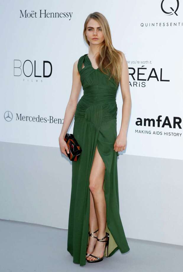 CAP D'ANTIBES, FRANCE - MAY 24:  Model Cara Delevingne arrives at the 2012 amfAR's Cinema Against AIDS during the 65th Annual Cannes Film Festival at Hotel Du Cap on May 24, 2012 in Cap D'Antibes, France. Photo: Andreas Rentz, Getty Images / 2012 Getty Images