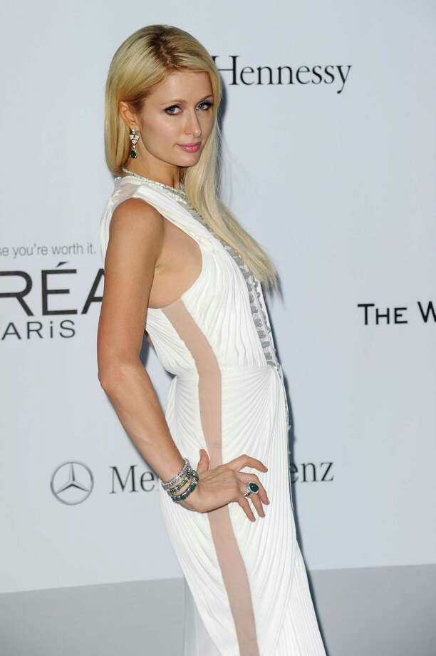 Paris Hilton arrives for the amfAR Cinema Against AIDS benefit at the Hotel du Cap-Eden-Roc, during the 65th Cannes film festival, in Cap d'Antibes, southern France, Thursday, May 24, 2012. Photo: Jonathan Short, Associated Press / SHORJ