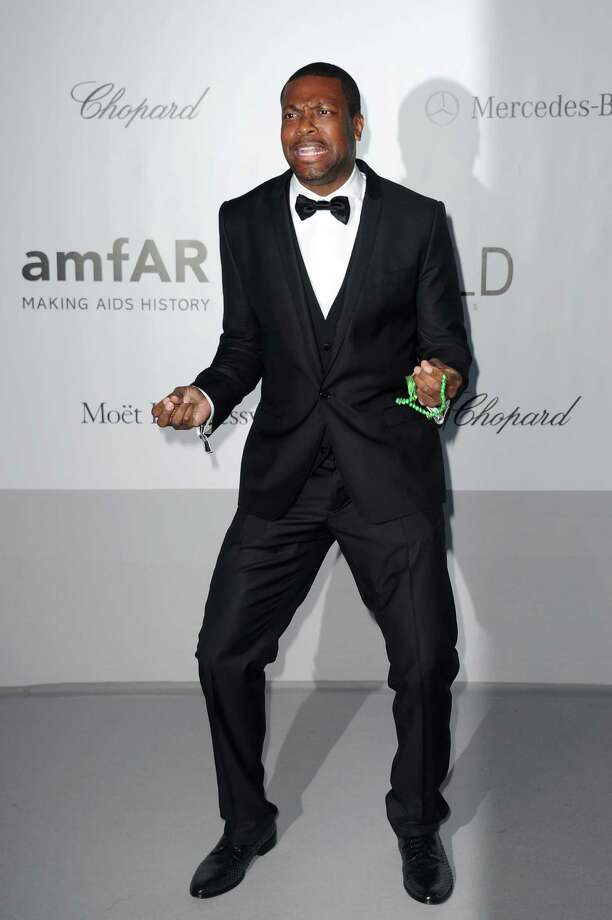 Actor Chris Tucker arrives for the amfAR Cinema Against AIDS benefit at the Hotel du Cap-Eden-Roc, during the 65th Cannes film festival, in Cap d'Antibes, southern France, Thursday, May 24, 2012. Photo: Jonathan Short, Associated Press / SHORJ