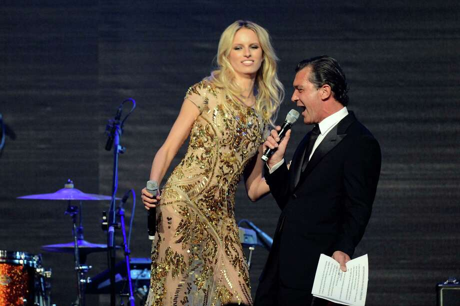 CAP D'ANTIBES, FRANCE - MAY 24:  (L-R) Model Karolina Kurkova and actor Antonio Banderas onstage during the 2012 amfAR's Cinema Against AIDS during the 65th Annual Cannes Film Festival at Hotel Du Cap on May 24, 2012 in Cap D'Antibes, France. Photo: Dave J Hogan, Getty Images / 2012 Getty Images