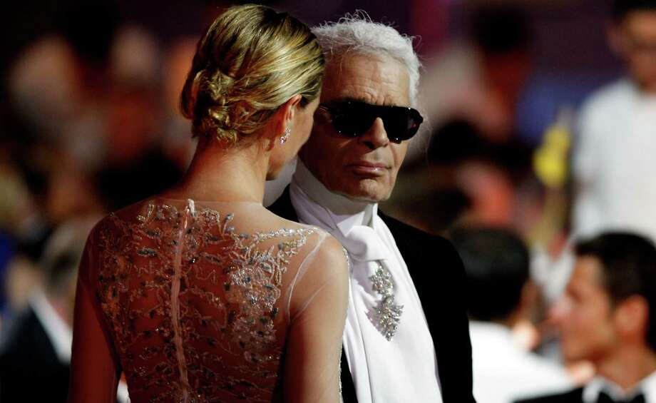 CAP D'ANTIBES, FRANCE - MAY 24:  (L-R) Heidi Klum and designer Karl Lagerfeld during the 2012 amfAR's Cinema Against AIDS during the 65th Annual Cannes Film Festival at Hotel Du Cap on May 24, 2012 in Cap D'Antibes, France. Photo: Andreas Rentz, Getty Images / 2012 Getty Images