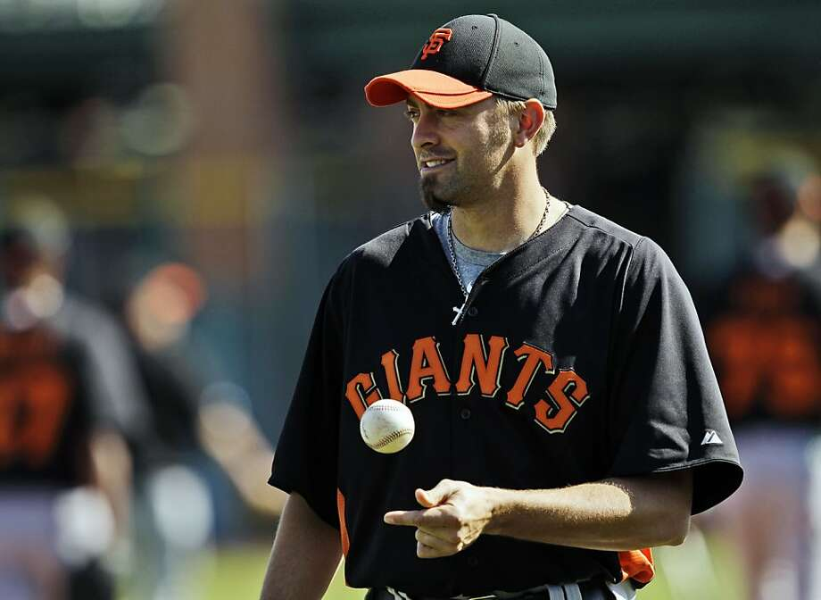 "FILE - In this Feb. 24, 2011, file photo, San Francisco Giants relief pitcher Jeremy Affeldt tosses a ball during spring training baseball facility in Scottsdale, Ariz. When he joined the San Francisco Giants five years ago, Affeldt became determined to get rid of his negative feelings toward the gay population. The transformation took time and a change of heart, given what he calls his ""sheltered"" upbringing in Eastern Washington. Now, Affeldt is more than comfortable saying he was wrong to judge a community based solely on sexual orientation. (AP Photo/Marcio Jose Sanchez, File) Photo: Marcio Jose Sanchez, Associated Press"