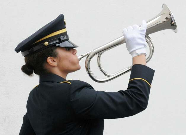 Private first class Tiara Conklin plays taps at a pre-Memorial Day ceremony honoring military members who have made the ultimate sacrifice to their country at the New York State Division of Military and Naval Affairs on Thursday, May 23, 2013 in Latham, N.Y.  (Lori Van Buren / Times Union) Photo: Lori Van Buren / 00022554A