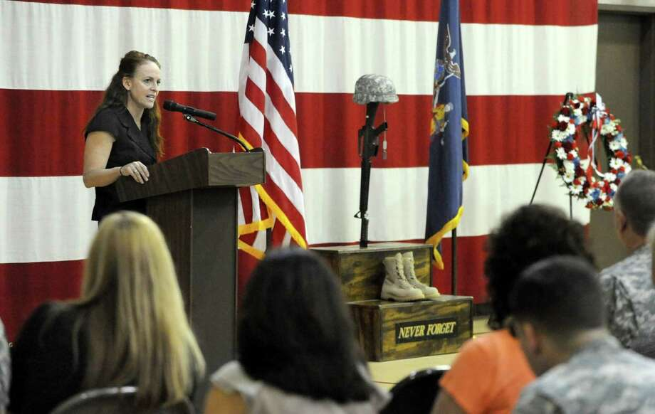 Mary Kavaney, Assistant Deputy Secretary for Public Safety, speaks on behalf of the Governor during a pre-Memorial Day ceremony honoring military members who have made the ultimate sacrifice to their country at the New York State Division of Military and Naval Affairs on Thursday, May 23, 2013 in Latham, N.Y.  (Lori Van Buren / Times Union) Photo: Lori Van Buren / 00022554A