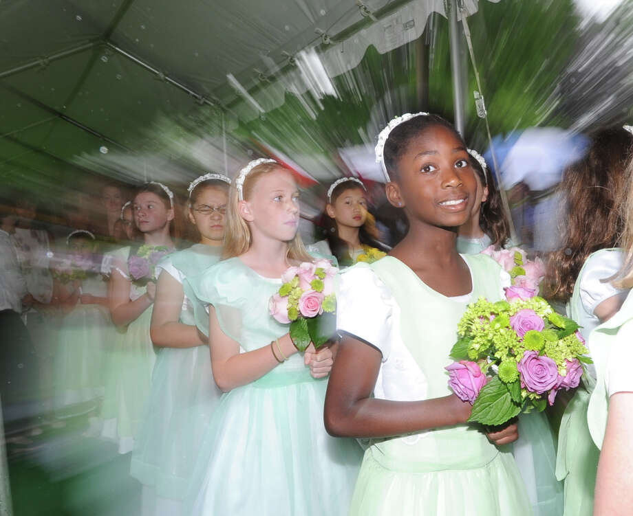 Flower girl Aiyanna Ojukwu during the Greenwich Academy graduation ceremony at the school in Greenwich, Thursday, May 23, 2013. Photo: Bob Luckey / Greenwich Time