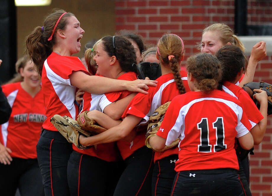 New Canaan celebrates its win over St. Jospeph, during FCIAC Softball Championship action at Sacred Heart University in Fairfield, Conn. on Thursday May 23, 2013. Photo: Christian Abraham / Connecticut Post