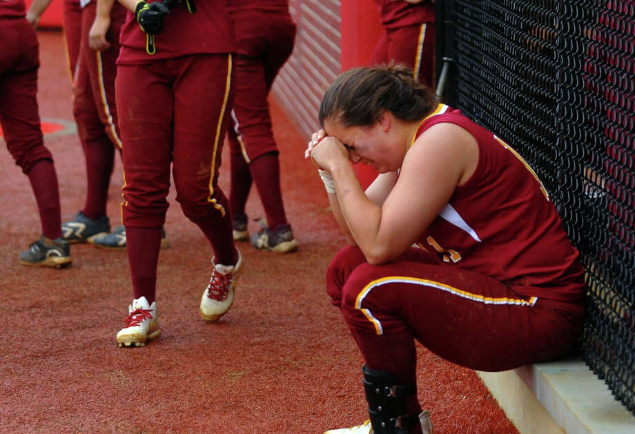 St. Jospeph's Jenn Vazquez sits dejected at the dugout after the team was defeated by New Canaan in FCIAC Softball Championship action at Sacred Heart University in Fairfield, Conn. on Thursday May 23, 2013. Photo: Christian Abraham / Connecticut Post