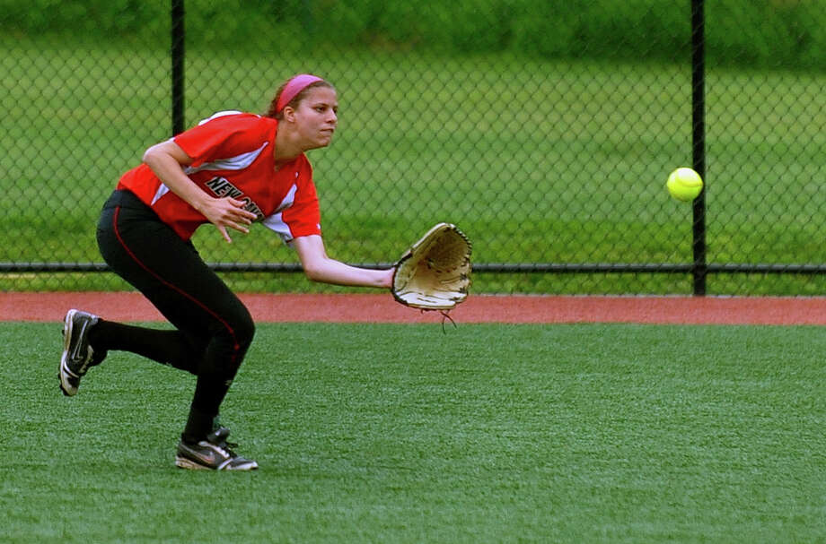 New Canaan center fielder Colette Pellegrini catches a St. Jospeph hit, during FCIAC Softball Championship action at Sacred Heart University in Fairfield, Conn. on Thursday May 23, 2013. Photo: Christian Abraham / Connecticut Post