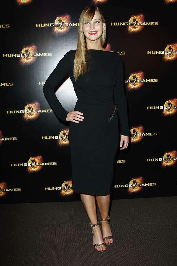 "At ""The Hunger Games"" Paris premiere on March 15, 2012, wearing Tom Ford. Photo: Julien Hekimian, Getty Images / 2012 Julien Hekimian"