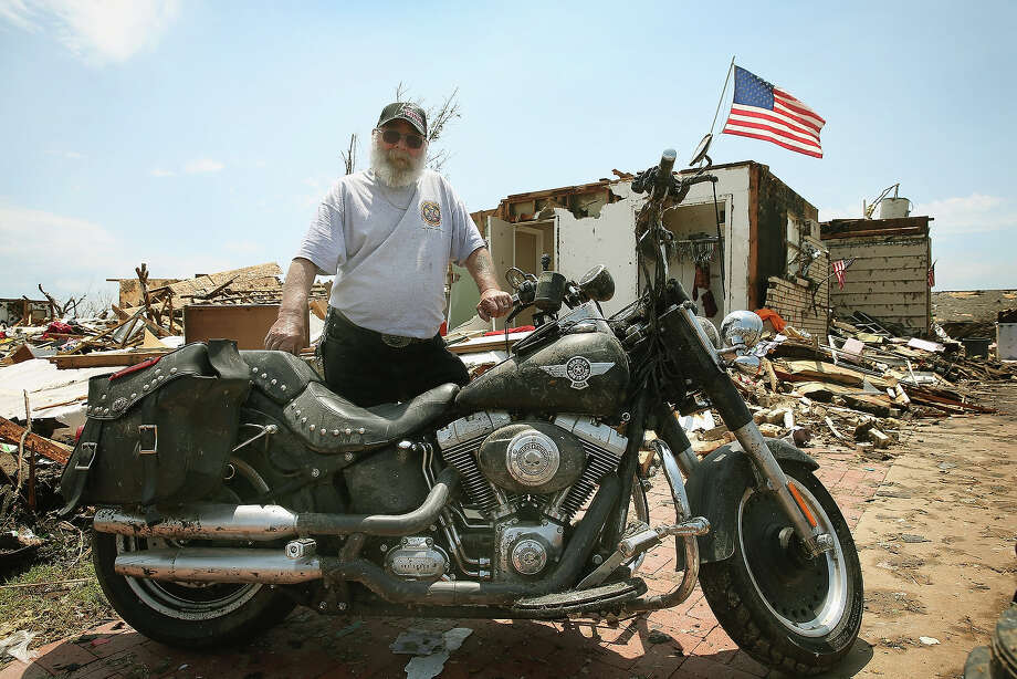Fred Martin stands next to his 2010 Harley Davidson Fatboy motorcycle after it was dug from the rubble of his home, which was destroyed by a tornado, on May 23, 2013 in Moore, Oklahoma. The motorcycle was one of the most important possessions the 72-year-old biker had hoped to recover from the rubble that was once his home. A two-mile wide EF5 tornado touched down in Moore May 20 killing at least 24 people and leaving behind extensive damage to homes and businesses. U.S. President Barack Obama promised federal aid to supplement state and local recovery efforts. Photo: Scott Olson, Getty Images / 2013 Getty Images