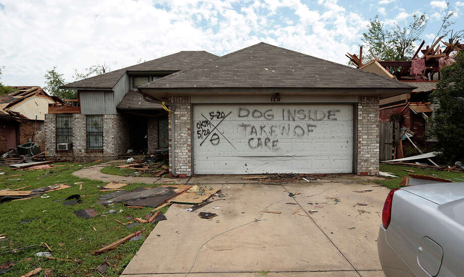 A house in the Southmoore neighborhood May 23, 2013  in Moore, Oklahoma. The tornado of at least EF4 strength and up to two miles wide touched down May 20 killing at least 24 people and leaving behind extensive damage to homes and businesses. U.S. President Barack Obama promised federal aid to supplement state and local recovery efforts. Photo: Brett Deering, Getty Images / 2013 Getty Images