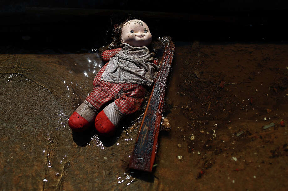 A child's doll lays amid the rubble of a destroyed home on May 23, 2013 in Moore, Oklahoma. The tornado of at least EF4 strength and two miles wide touched down May 20 killing at least 24 people and leaving behind extensive damage to homes and businesses. U.S. President Barack Obama promised federal aid to supplement state and local recovery efforts. Photo: Tom Pennington, Getty Images / 2013 Getty Images