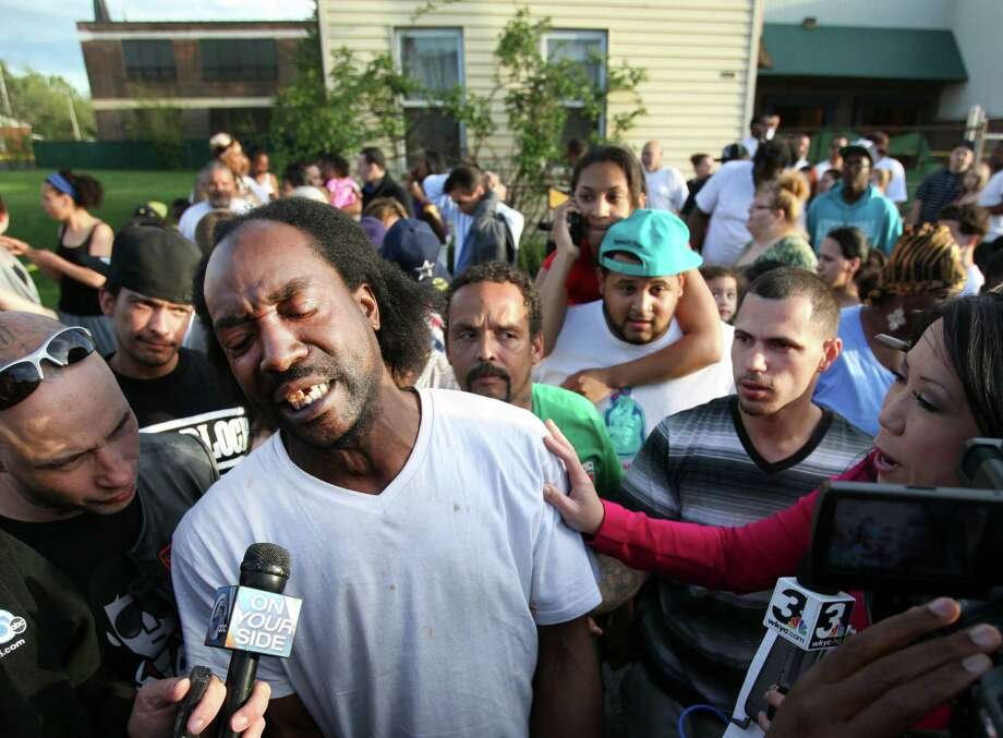 FILE - This May 6, 2013 file photo shows neighbor Charles Ramsey speaking to media near the home where missing women Amanda Berry, Gina DeJesus and Michele Knight were rescued in Cleveland. Ramsey, the man who famously put down his Big Mac to help rescue three women held captive for a decade in an Ohio house will never have to pay for another burger in his hometown. Ramsey has been promised free burgers for life at more than a dozen Cleveland-area restaurants. (AP Photo/The Plain Dealer, Scott Shaw, File) Photo: Scott Shaw