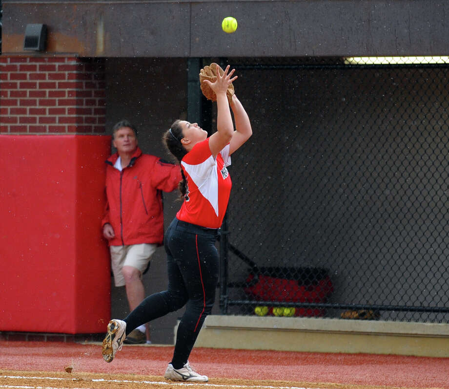 New Canaan's Amanda Frattaroli catches a St. Jospeph hit, during FCIAC Softball Championship action at Sacred Heart University in Fairfield, Conn. on Thursday May 23, 2013. Photo: Christian Abraham / Connecticut Post