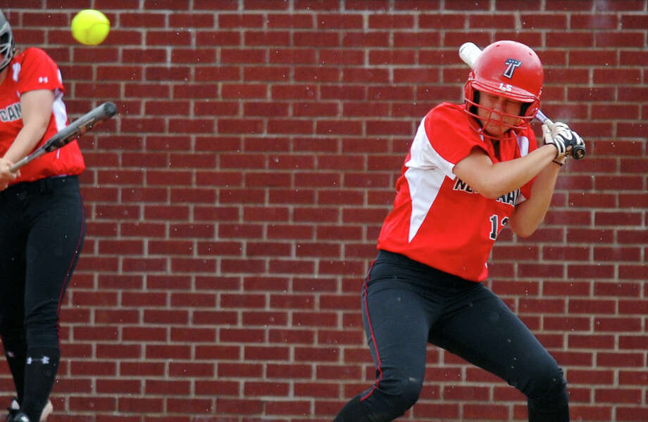 New Canaan's Courtney Rogers ducks a high pitch, during FCIAC Softball Championship action against St. Joseph at Sacred Heart University in Fairfield, Conn. on Thursday May 23, 2013. Photo: Christian Abraham / Connecticut Post