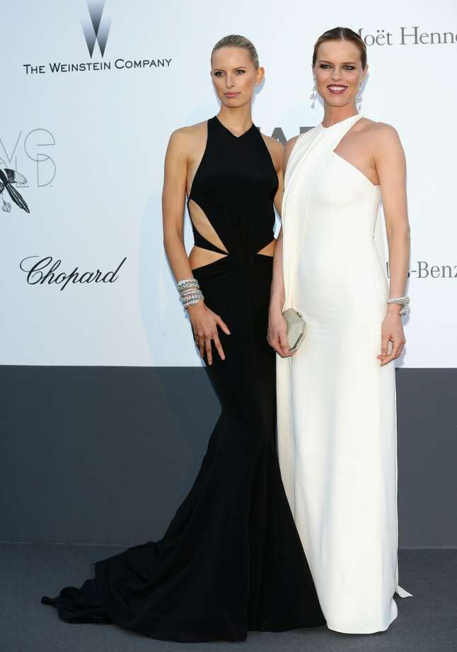 CAP D'ANTIBES, FRANCE - MAY 23:  Models Karolina Kurkova and Eva Herzigova attend amfAR's 20th Annual Cinema Against AIDS during The 66th Annual Cannes Film Festival at Hotel du Cap-Eden-Roc on May 23, 2013 in Cap d'Antibes, France.  (Photo by Vittorio Zunino Celotto/French Select via Getty Images)