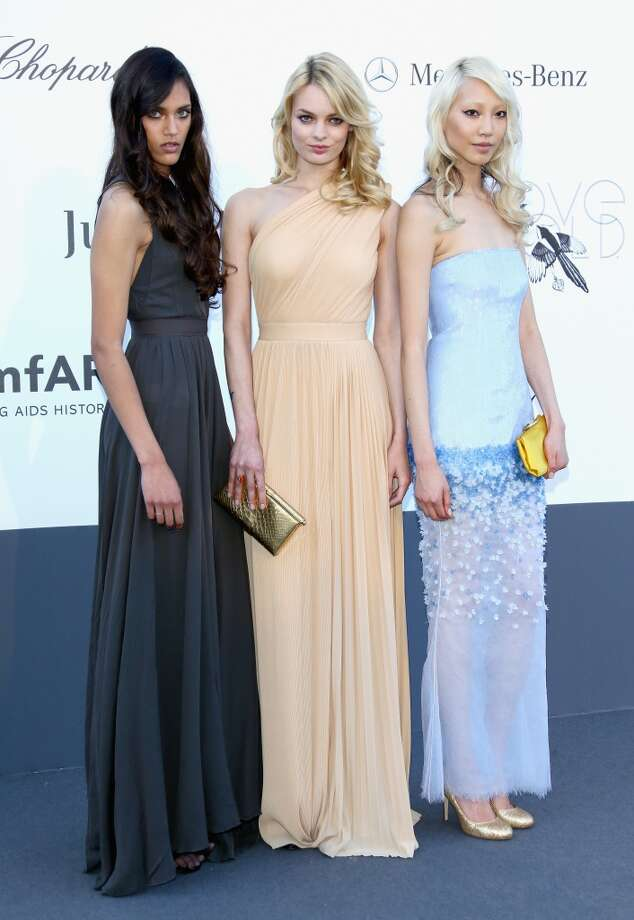 CAP D'ANTIBES, FRANCE - MAY 23:  (L-R) Models Dalianah Arekion, Stephanie van der Laan and Soo Joo Park attend amfAR's 20th Annual Cinema Against AIDS during The 66th Annual Cannes Film Festival at Hotel du Cap-Eden-Roc on May 23, 2013 in Cap d'Antibes, France.  (Photo by Vittorio Zunino Celotto/French Select via Getty Images)