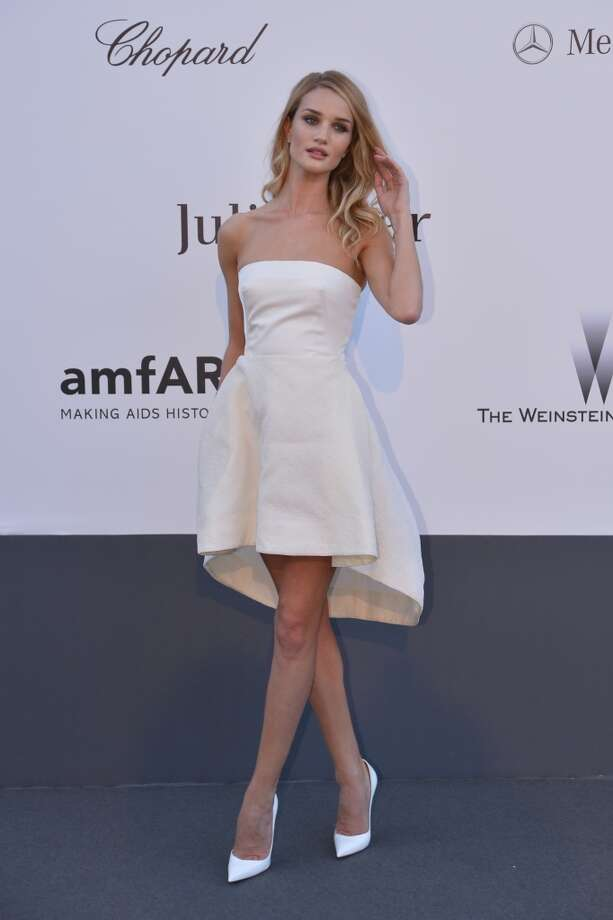 British model Rosie Huntington-Whiteley poses on May 23, 2013 as she arrives for the amfAR's 20th Annual Cinema Against AIDS during the 66th Annual Cannes Film Festival at Hotel du Cap-Eden-Roc in Cap d'Antibes, southern France.   AFP PHOTO / ALBERTO PIZZOLIALBERTO PIZZOLI/AFP/Getty Images
