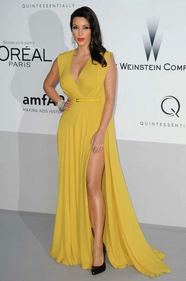 Kim Kardashian arrives for the amfAR Cinema Against AIDS benefit at the Hotel du Cap-Eden-Roc, during the 65th Cannes film festival, in Cap d'Antibes, southern France, Thursday, May 24, 2012. Photo: Jonathan Short, Associated Press / SHORJ
