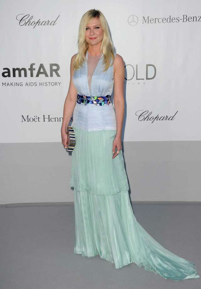 Kirsten Dunst arrives for the amfAR Cinema Against AIDS benefit at the Hotel du Cap-Eden-Roc, during the 65th Cannes film festival, in Cap d'Antibes, southern France, Thursday, May 24, 2012. Photo: Jonathan Short, Associated Press / SHORJ