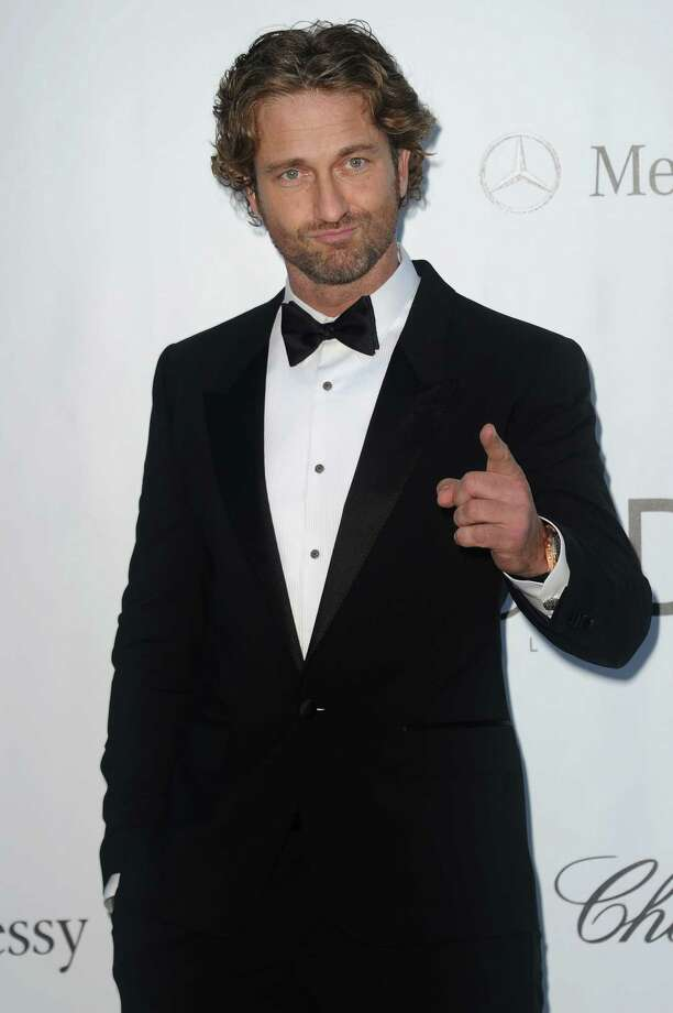 Gerard Butler arrives for the amfAR Cinema Against AIDS benefit at the Hotel du Cap-Eden-Roc, during the 65th Cannes film festival, in Cap d'Antibes, southern France, Thursday, May 24, 2012. Photo: Jonathan Short, Associated Press / SHORJ