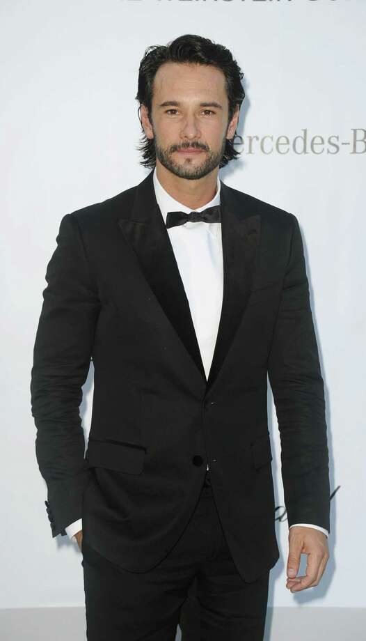 Actor Rodrigo Santoro arrives for the amfAR Cinema Against AIDS benefit at the Hotel du Cap-Eden-Roc, during the 65th Cannes film festival, in Cap d'Antibes, southern France, Thursday, May 24, 2012. Photo: Jonathan Short, Associated Press / SHORJ