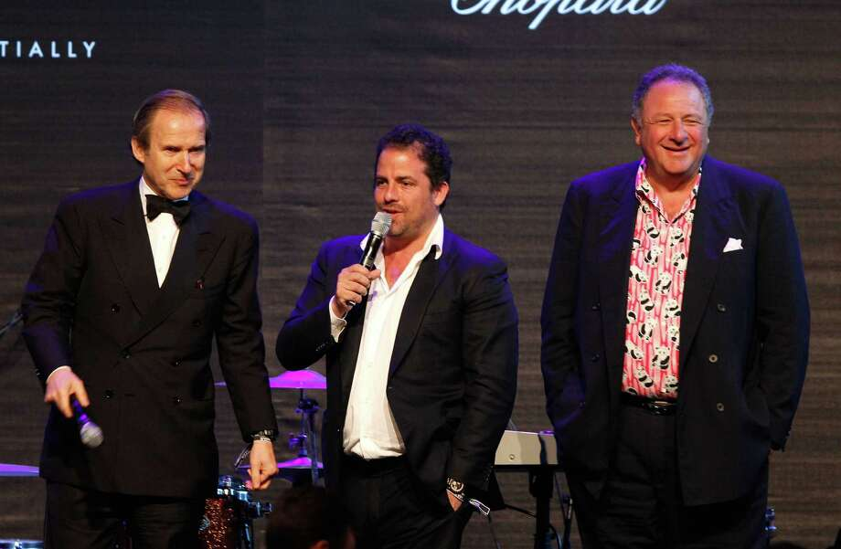 CAP D'ANTIBES, FRANCE - MAY 24: (L-R) Simon de Pury, Brett Ratner and Jean 'Johnny' Pigozzi speak onstage during the 2012 amfAR's Cinema Against AIDS during the 65th Annual Cannes Film Festival at Hotel Du Cap on May 24, 2012 in Cap D'Antibes, France. Photo: Andreas Rentz, Getty Images / 2012 Getty Images