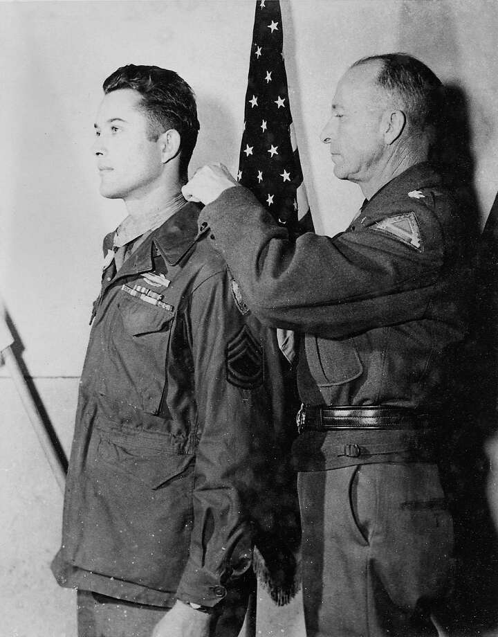 Sgt. Homer L. Wise receives the Medal of Honor from Lt. General Alexander M. Patch, Commanding General Seventh Army, in Epinal, France, November 28, 1944 for heroism in Magalino, Italy, June 14, 1944  contributed photo Photo: Contributed Photo, GT / Greenwich Time