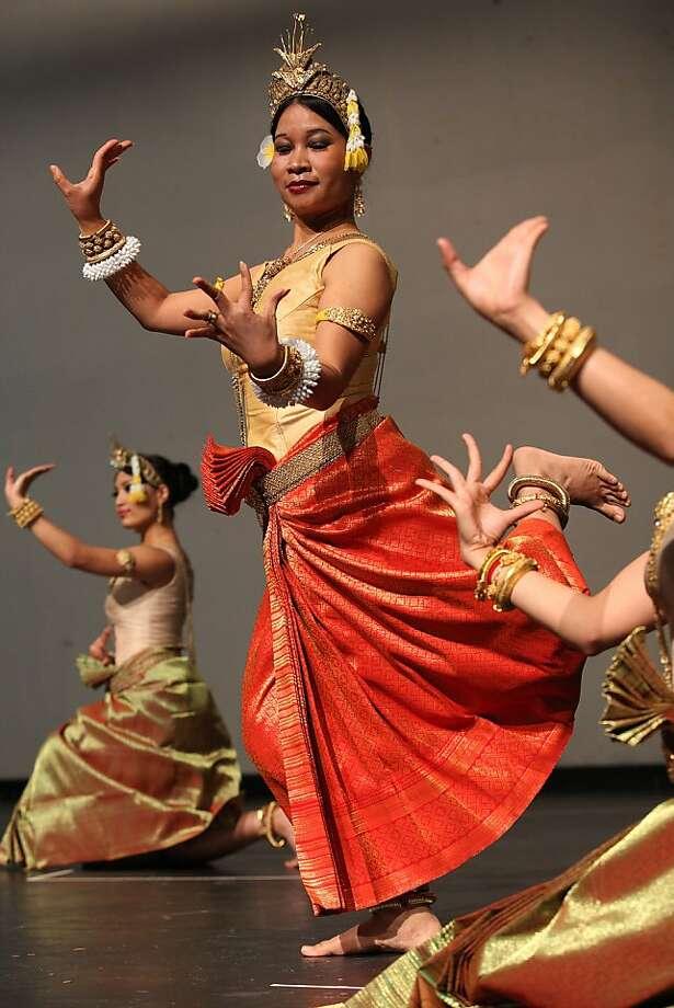 """Choreographer Charya Burt (in orange skirt) rehearses """"Blossoming Antiquities,"""" which her troupe will perform. Photo: Liz Hafalia, The Chronicle"""