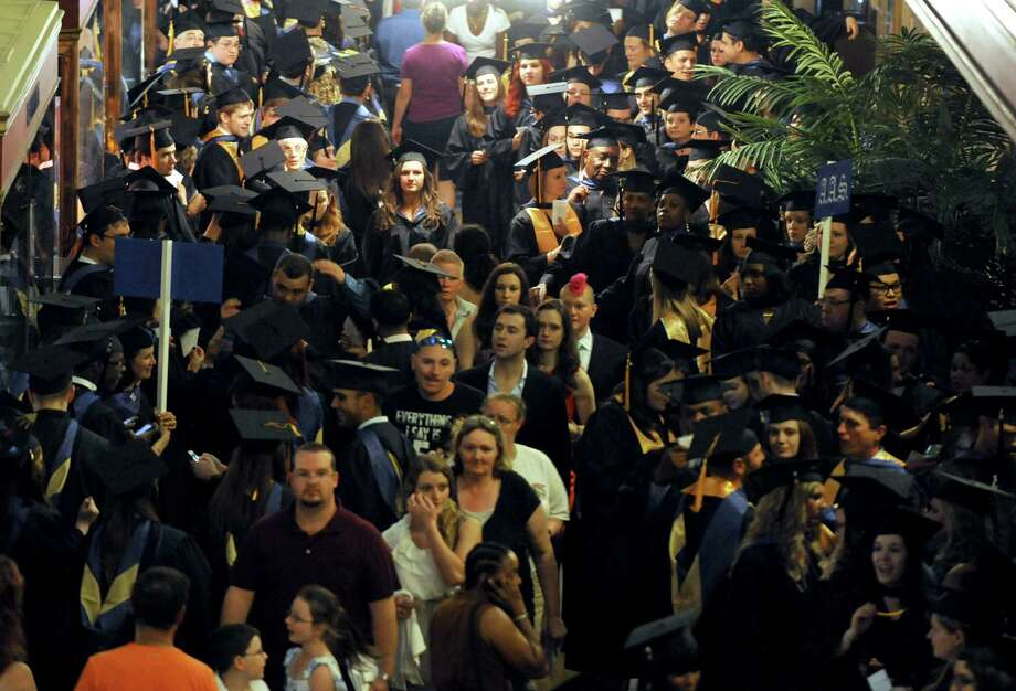 Graduates line up for the processional during Schenectady County Community College's Forty-Third graduation commencement at Proctors on Thursday May 23, 2013 in Schenectady, N.Y. (Michael P. Farrell/Times Union) Photo: Michael P. Farrell