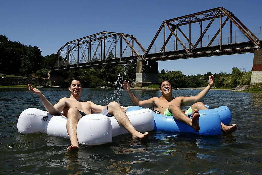 Clark Whitehead (left), and Eduardo De Arkos, founders of Innovative Water Sports, float on Fluzzle Tubes at Healdsburg Veterans Memorial Beach. The tubes, below, are shaped like puzzle pieces and can be linked together. Photo: Liz Hafalia, The Chronicle