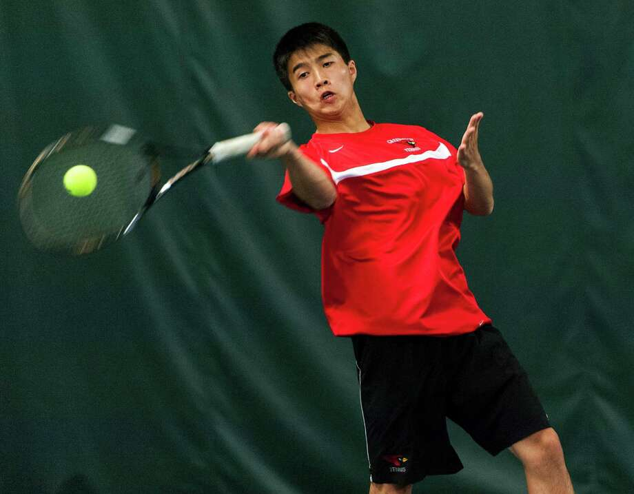 Greenwich high school's Mark Chien returns a serve during a FCIAC boys tennis championship doubles matach against Staples high school's Jared Eisenberg and Baxter Stein played at Shippan Racquet Club, Stamford, CT on Thursday May 23rd, 2013. Mark's doubles partner was Axel Hebrand Photo: Mark Conrad / Stamford Advocate Freelance