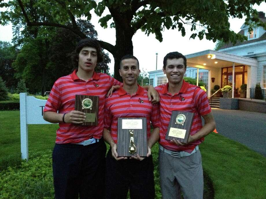 Paul Pastore, left and Danny Guise, right, pose with coach Jeff Santilli after winning the Chappa Invitational Tournament on Thursday at Longshore Golf Course in Westport, Conn. on May 23, 2013. Photo: Contributed Photo