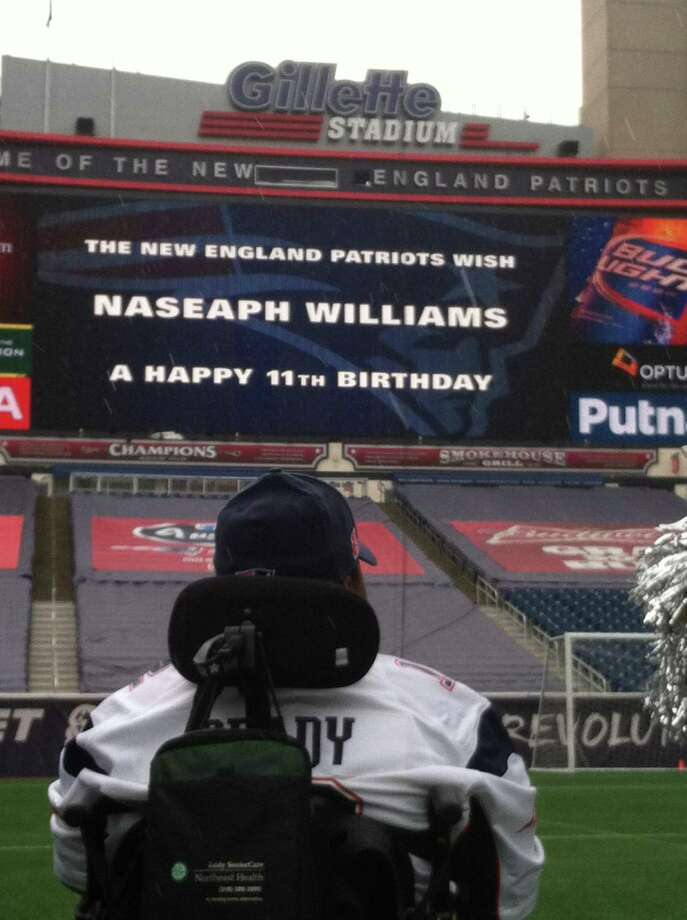 NaSeaph Williams of Saratoga Springs reads a message to him on the scoreboard at Gillette Stadium, home of the New England Patriots.
