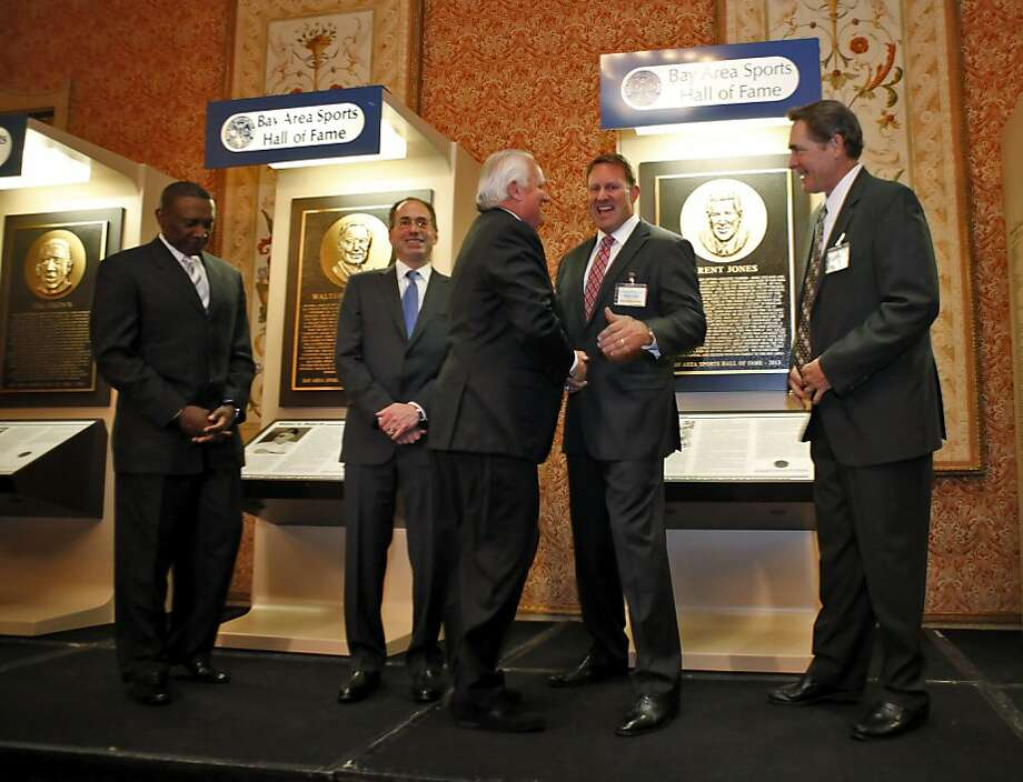 (l-r) Tim Brown, Wally Haas, Kevin O'Brien (president and CEO of BASHOF) Brent Jones and Dave Righetti gather on stage before a group photo on Thursday. Bay Area sports notables gathered at the Westin St. Francis to honor the newest inductees into the Bay Area Sports Hall of Fame in San Francisco, Calif., on Thursday, May 23, 2013. New inductees include Tim Brown of the Raiders, Dave Righetti of the Giants, Walter A. Haas, Jr., and Brent Jones of the 49ers. Photo: Carlos Avila Gonzalez, The Chronicle