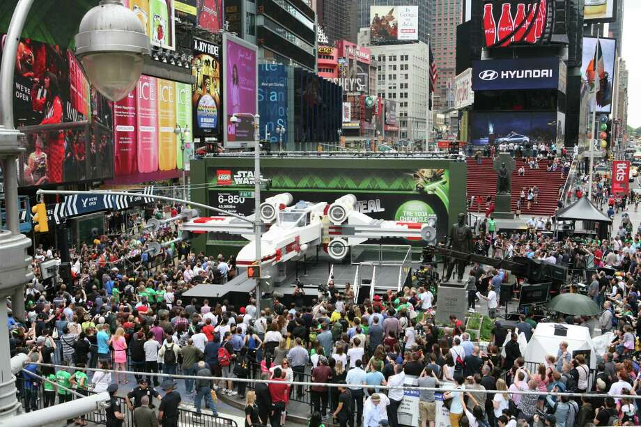 IMAGE DISTRIBUTED FOR LEGO SYSTEMS, INC. - Thousands gather in New York City's Times Square to watch the unveiling of the world's largest LEGO Model, a 1:1 replica of the LEGO Star Wars X-wing Starfighter that took 32 Model Builders, 5.3 million LEGO bricks and over 17,000 hours to complete, Thursday May 23, 2013. (Amy Sussman/AP Images for The LEGO Group) Photo: Amy Sussman