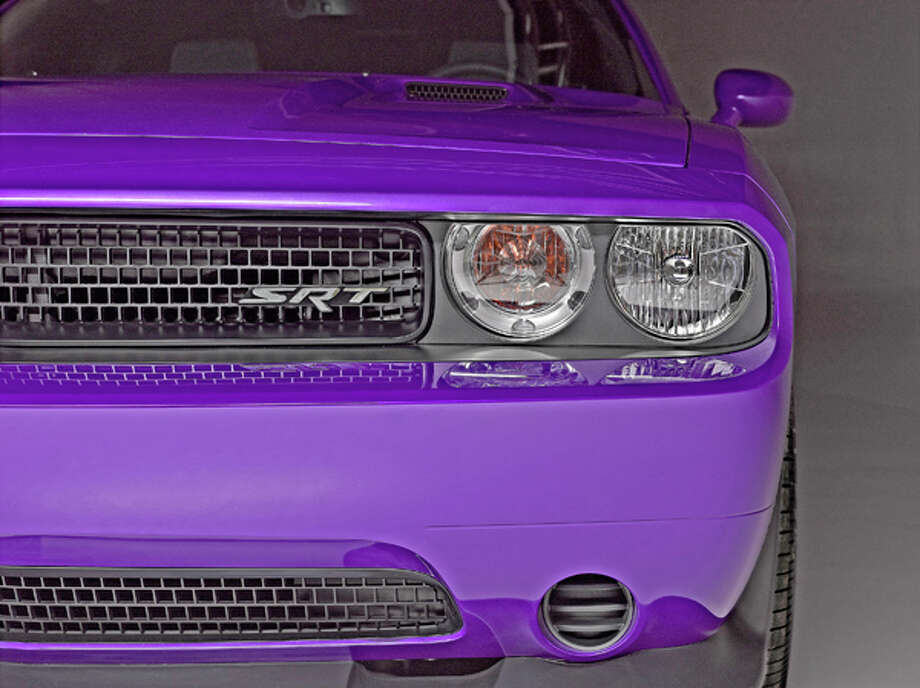 "Color options for the 2013 Challenger SRT8 ""Core"" model include Plum Crazy, Hemi Orange and TorRed, among others.  Challenger buyers can link their 392 c.i.d Hemi to either a six speed manual or five speed automatic transmission.   SRT's estimated quarter mile times are mid-12's for the automatic, high 12's with the stick.  Top speed estimated at 182 mph (Manual), 175 (auto).  MSRP is $38,995 & $995 destination."