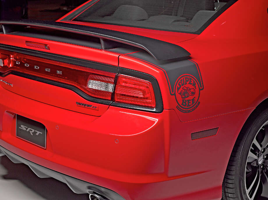 Graphics for the 2013 Dodge Charger SRT8 Super Bee include 3-D helmeted bee mascot, 392 HEMI badges and retro, round Super Bee logos.  Color charts include Hemi Orange, Plum Crazy and TorRed, among others.  Twenty inch, five spoke cast aluminum rims carry over from 2012.    Performance numbers for the Hemi powered Super Bee include 0-100-0 mph in under 16 seconds, a top speed of 175 mph.  Stopping power will haul down the core cars from 60-0 mph in 120 feet (117 for Challenger).    MSRP is $41,995 & $995 destination.