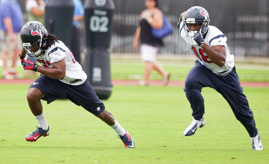 Knowing there's additional competition afoot, wide receivers Keshawn Martin, left, and Lestar Jean do their best to stand out during the Texans' organized team activities. Photo: Brett Coomer, Staff / © 2013 Houston Chronicle
