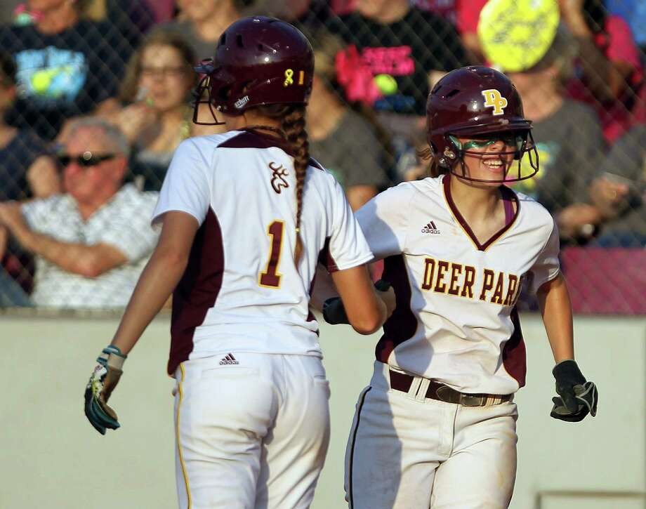 Deer Park High School's Caitlin Plocheck (1) and Rhonda Jarvis celebrate after they both scored runs during the second inning of the 5A Region III final high school softball game, Thursday, May 23, 2013, at the Cougar Softball Complex in Houston. Photo: Nick De La Torre, Chronicle / © 2013 Houston Chronicle