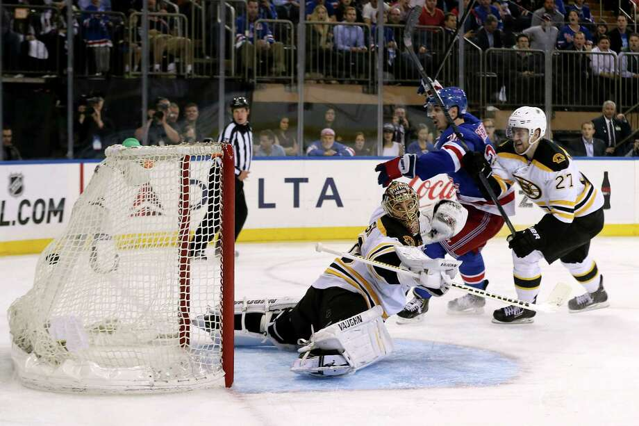 NEW YORK, NY - MAY 23:  Chris Kreider #20 of the New York Rangers celebrates his game-winning goal in overtime against goalie Tuukka Rask #40 and Dougie Hamilton #27 of the Boston Bruins in Game Four of the Eastern Conference Semifinals during the 2013 NHL Stanley Cup Playoffs at Madison Square Garden on May 23, 2013 in New York City.  (Photo by Bruce Bennett/Getty Images) Photo: Bruce Bennett