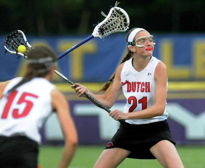 Guilderland's Morgan Hardt, right, fires a shot during their Section II Class A final against Shaker