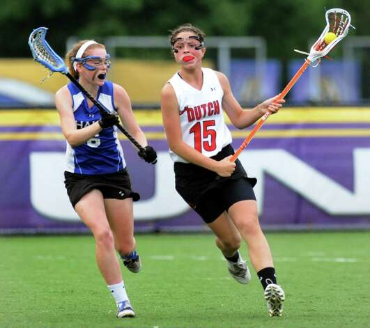 Guilderland's Cara Quimby, right, carries the ball as Shaker's Erin Sorday defends during their Section II Class A final on Thursday, May 23, 2013, at UAlbany in Albany, N.Y. (Cindy Schultz / Times Union) Photo: Cindy Schultz / 00022486A