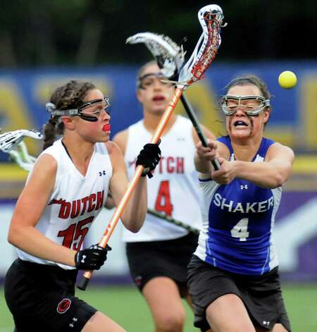 Guilderland's Cara Quimby, left, battles for a loose ball with Shaker's Sarah Cheney, right, during their Section II Class A final on Thursday, May 23, 2013, at UAlbany in Albany, N.Y. (Cindy Schultz / Times Union) Photo: Cindy Schultz / 00022486A